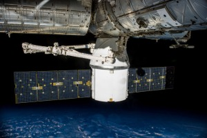 The Dragon is berthed to harmony node on the ISS. Photo by NASA.