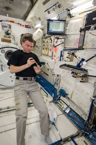 Astronaut Reid Weisman prepares to actuate the fixative onto our BRIC-19 samples.